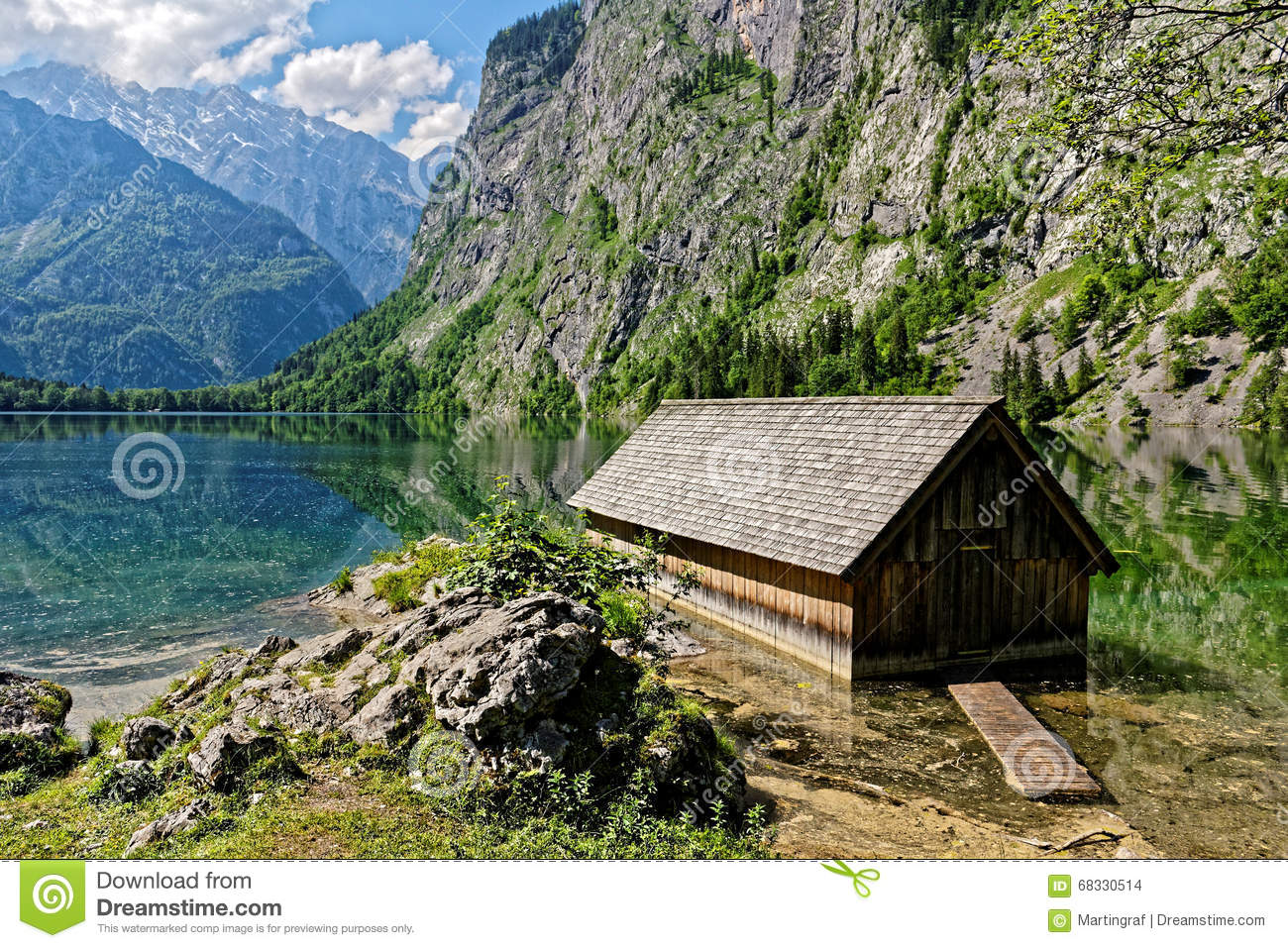Old boathouse in scenic alpine landscape