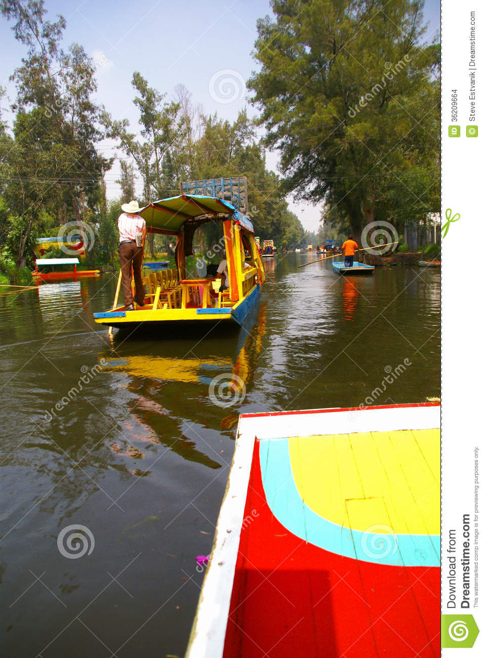 Boatman Poling Brightly Colored Boat Stock Photo - Image of mexican ...