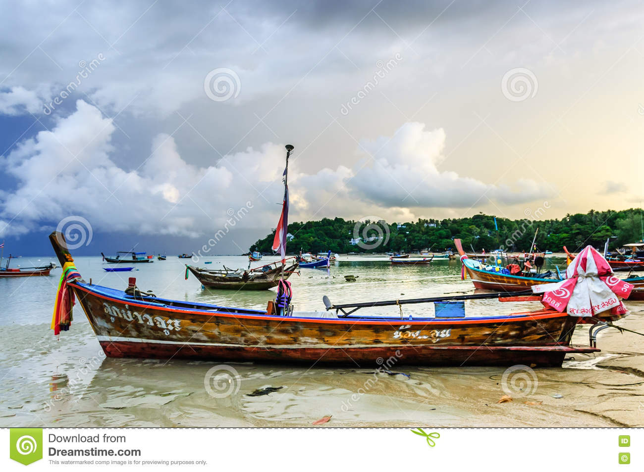 Boats at anchor at sunset rawai beach phuket thailand for Long beach fishing boat