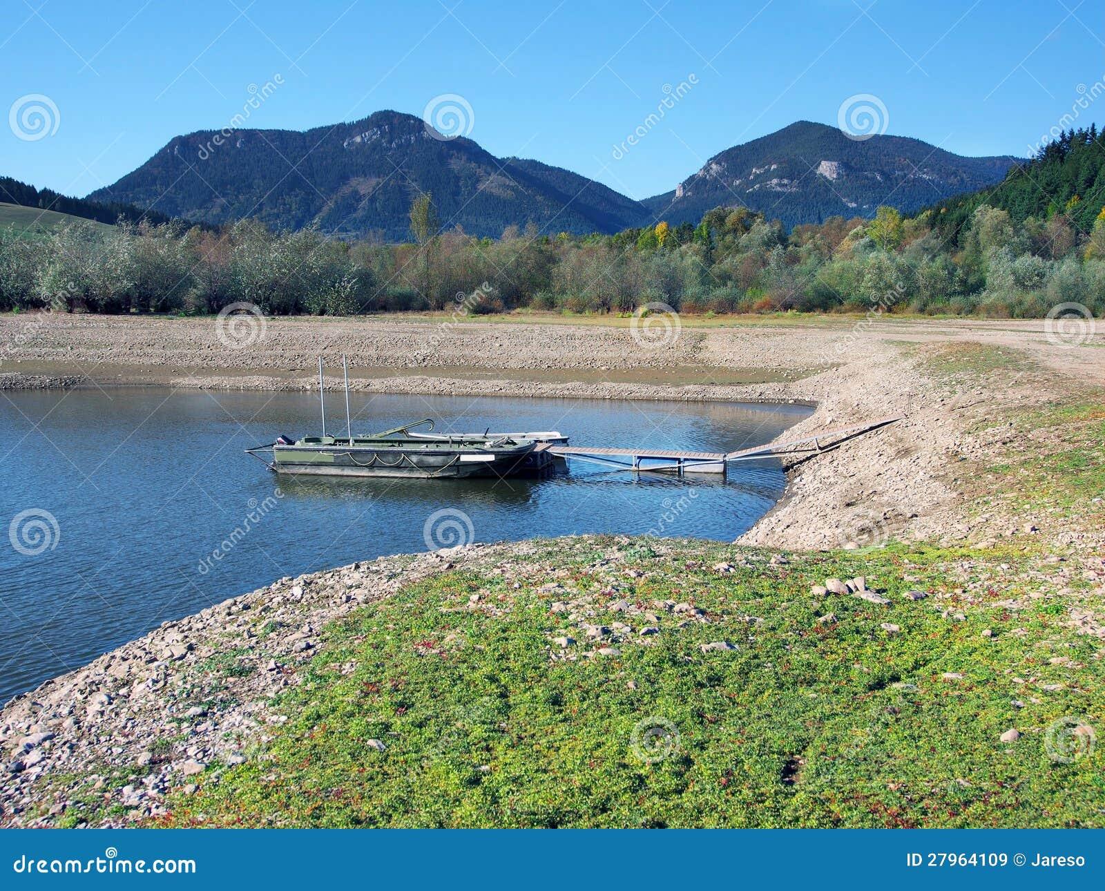 Boats anchored at shore of Liptovska Mara Lake