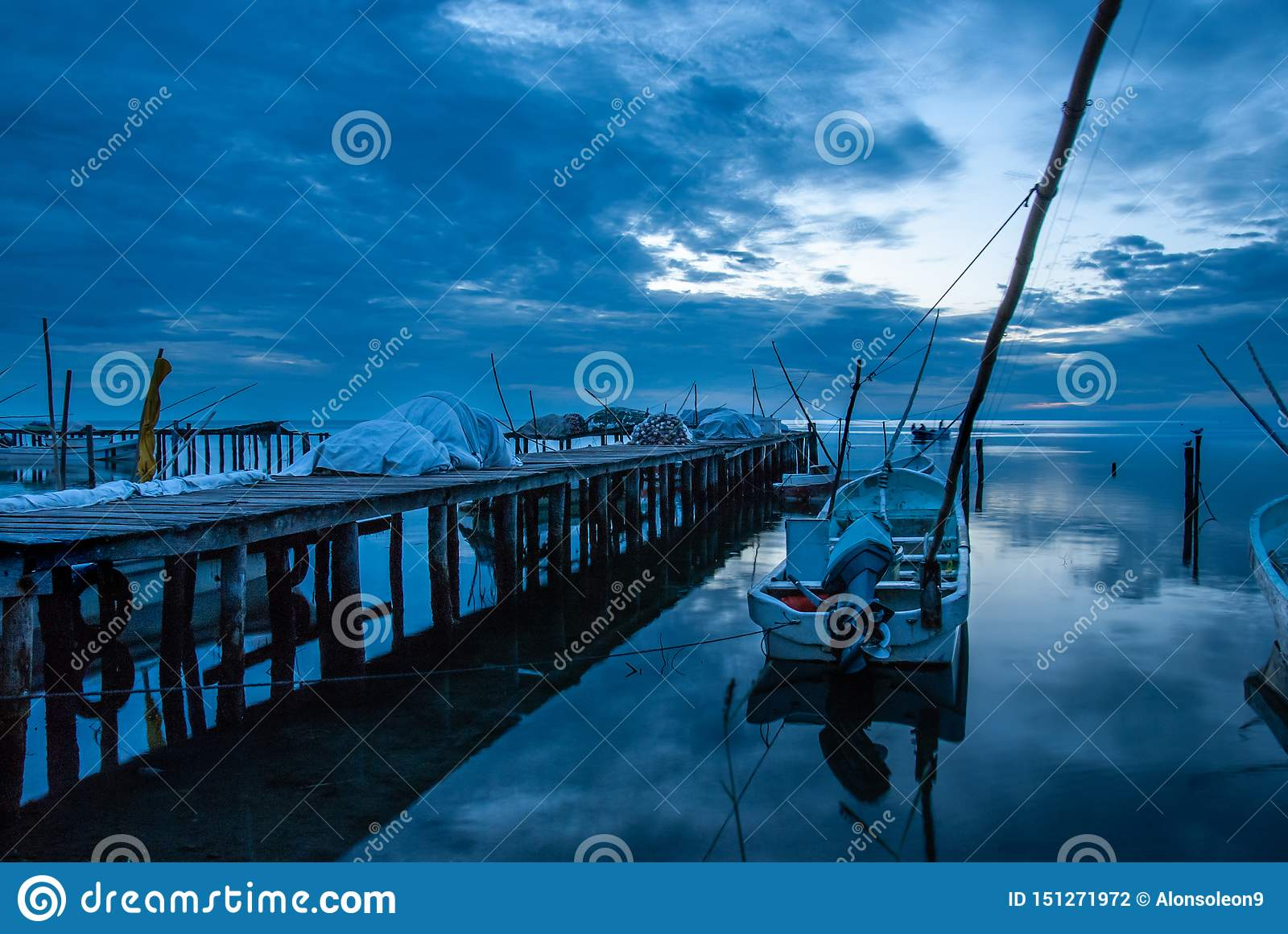 Boats in the dock and the blue sunset in Campeche Mexico