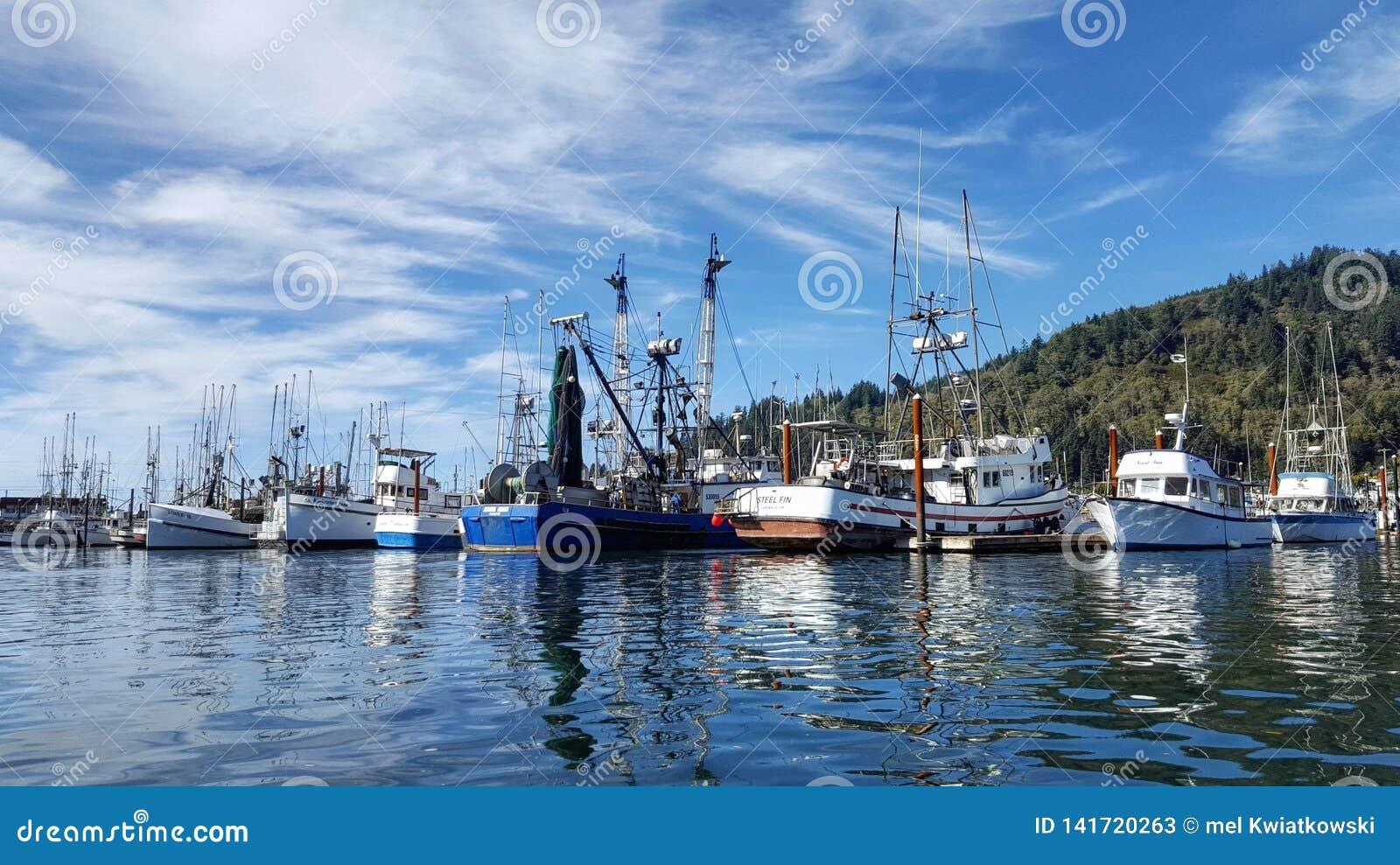 Boats by the docks in Tillamook Bay Oregon