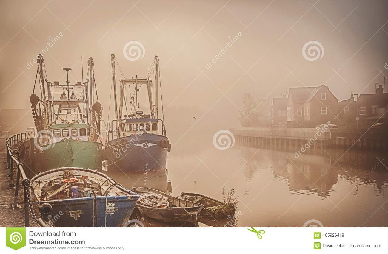 Boats on a foggy river.