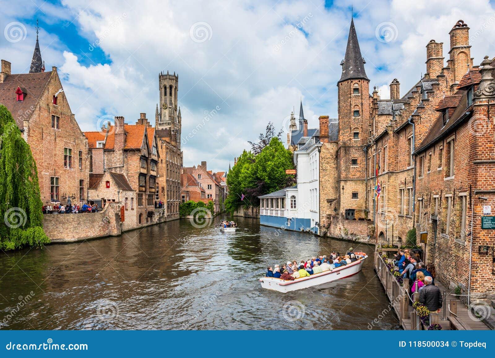 Boats full of tourist enjoying Bruges