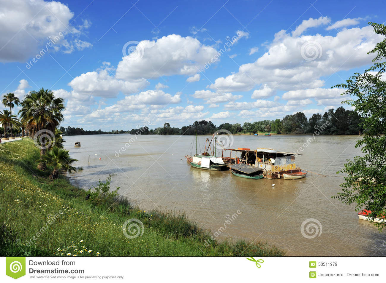 Boats on the Guadalquivir River as it passes through Coria del Rio, Seville province, Andalusia, Spain