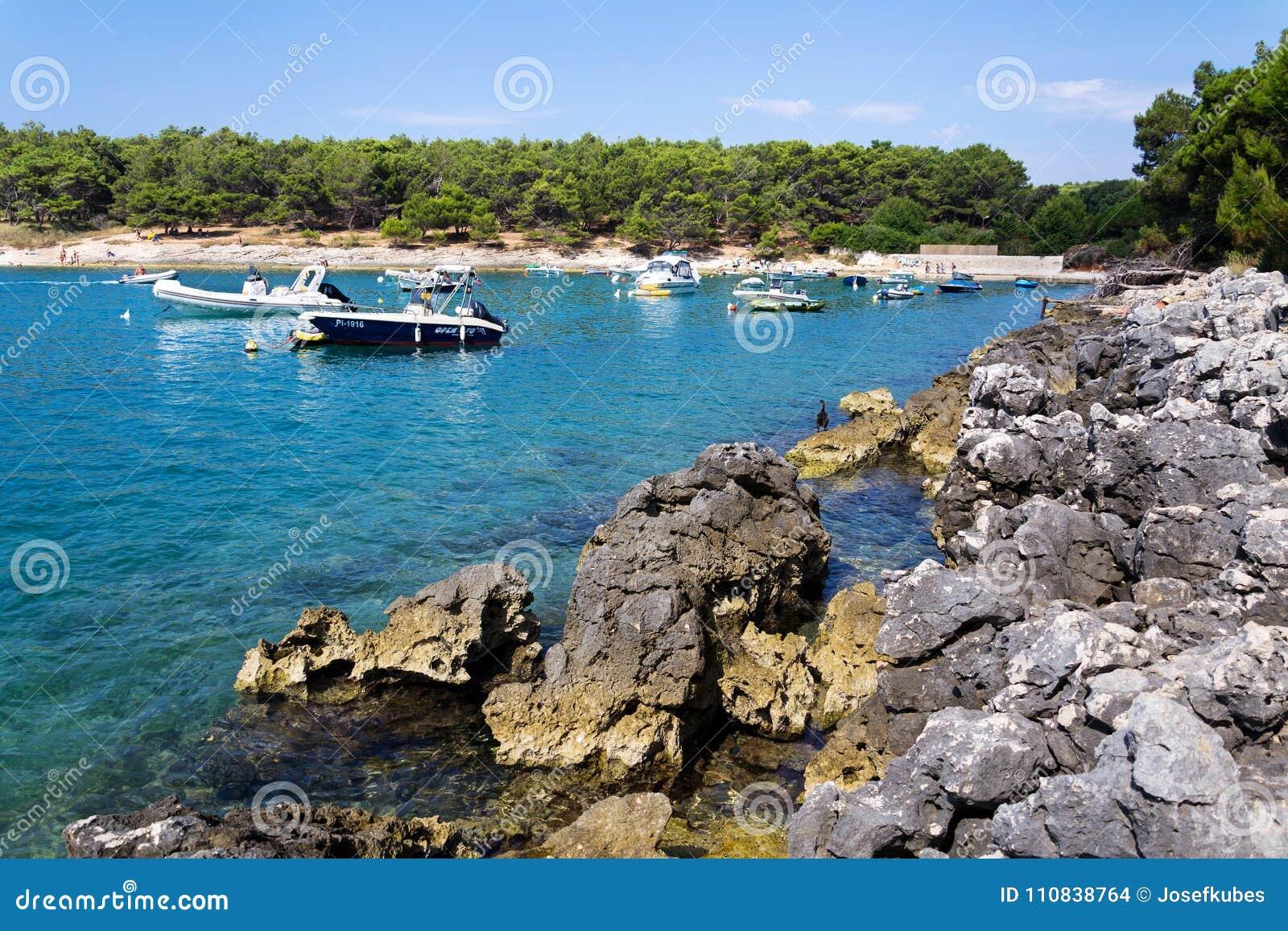 Boats on Kamenjak peninsula by the Adriatic Sea in Premantura, Croatia.