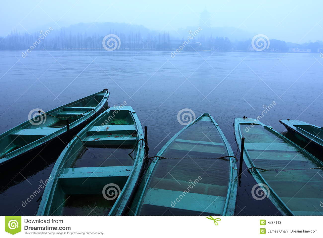 boats in the lake raining