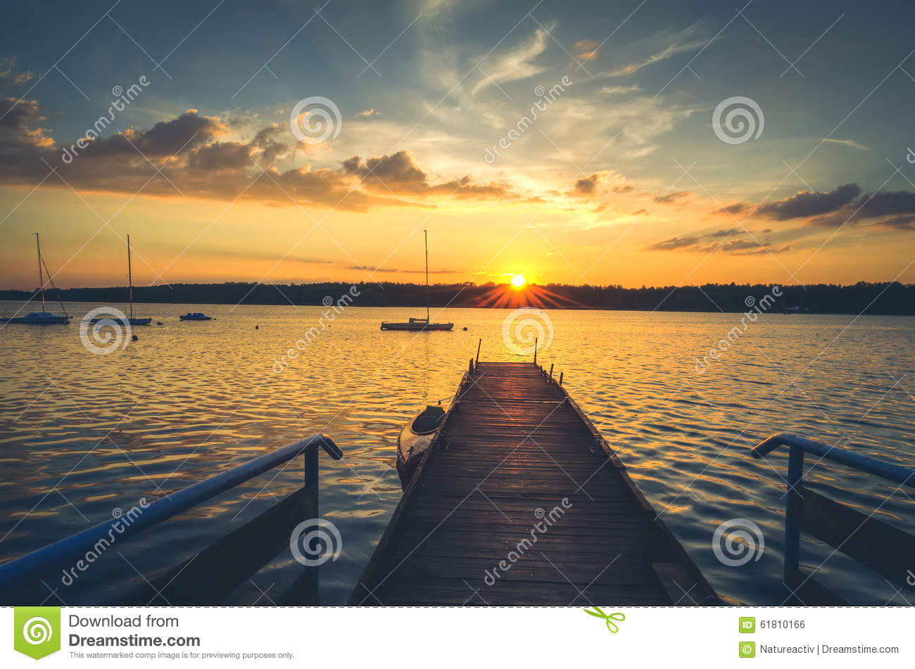 Boats and pier in lake.