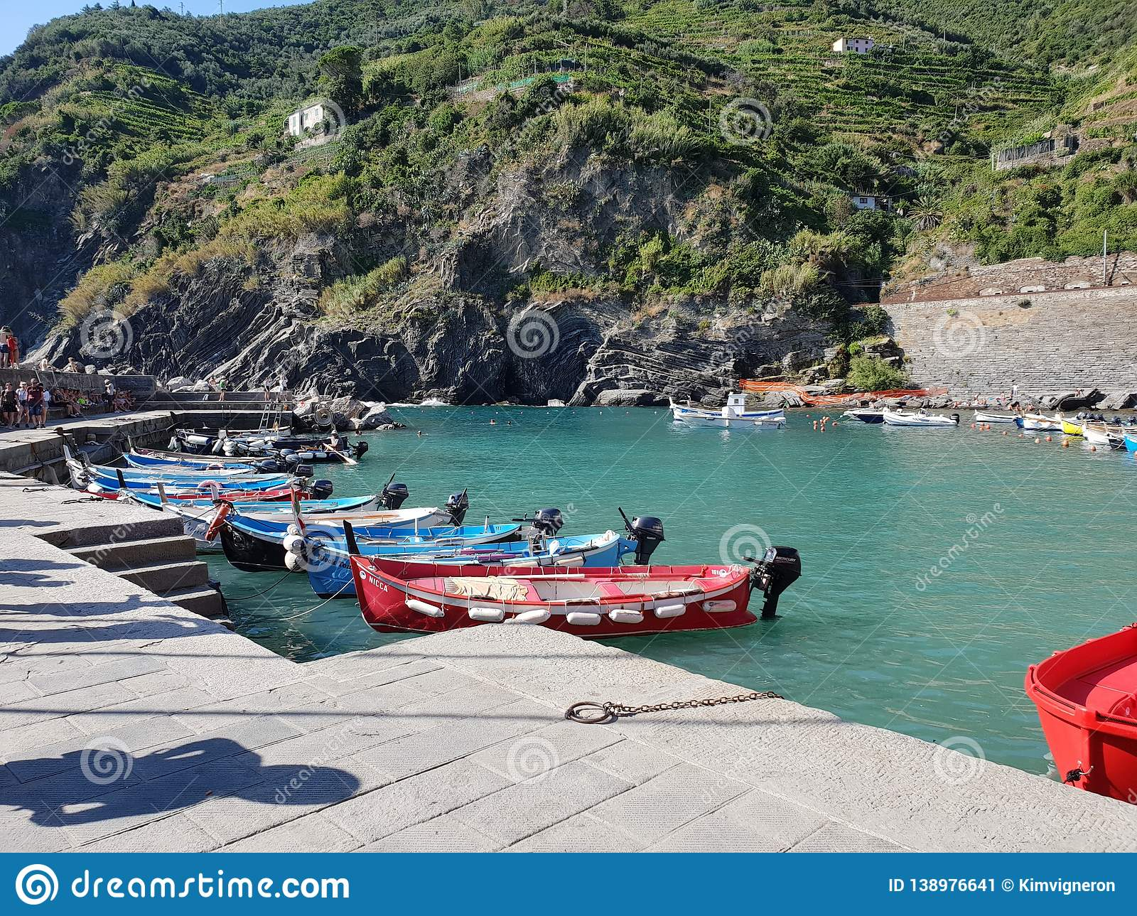 Boats in a port in Cinque Terre, Italy. With green mountains stock image