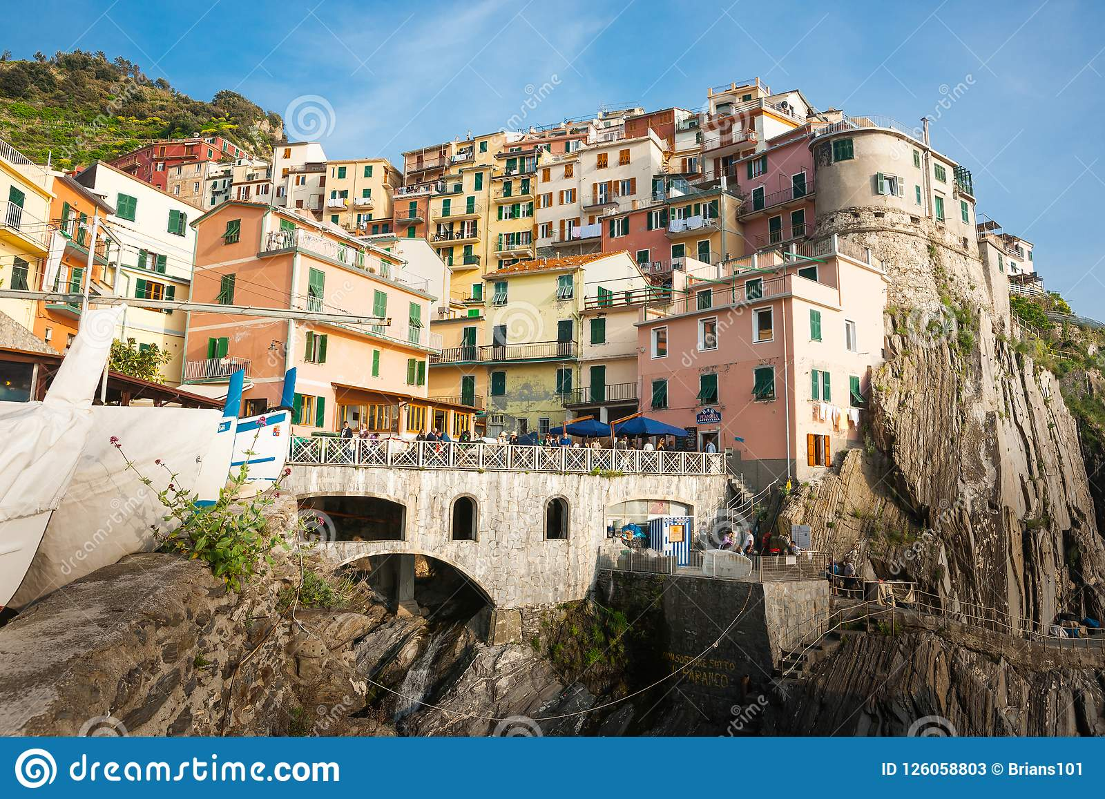 boats-pulled-up-below-steep-colored-hillside-village-buildings-manarola-italy-april-built-rock-cliff-face-cinque-terre-126058803.jpg