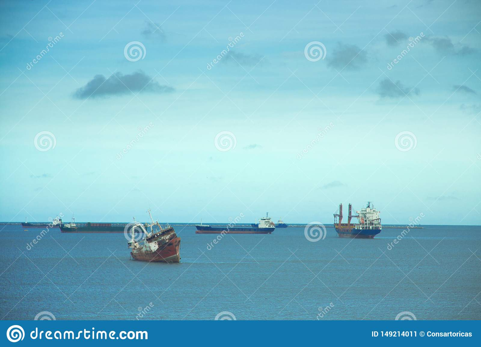 Boats on the sea with a big sky on them