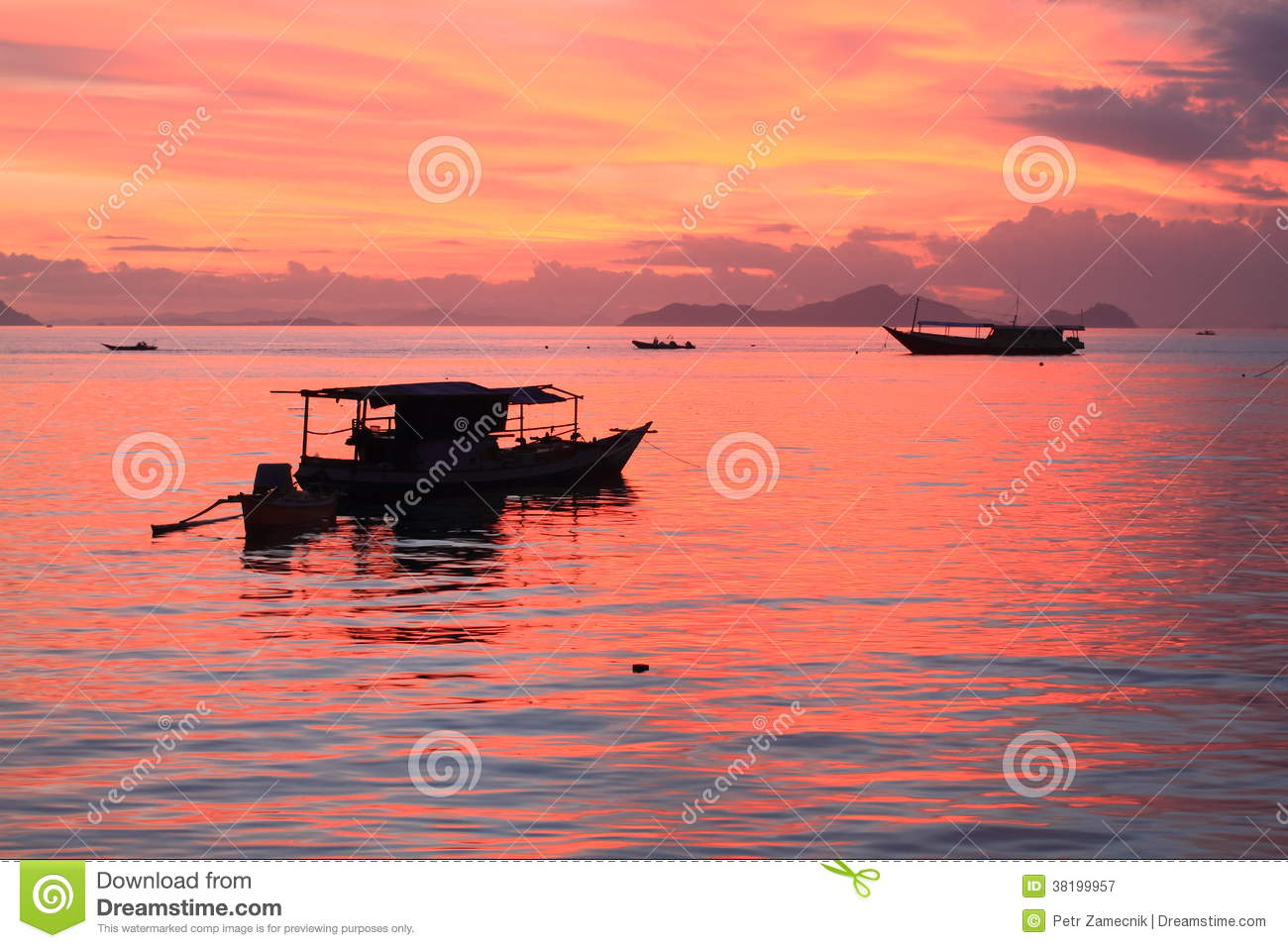 Boats on sunset sea