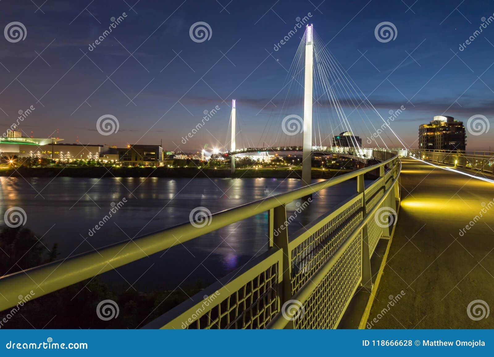 Bob Kerrey foot bridge with Omaha Nebraska skyline with beautiful sky colors just after sunset
