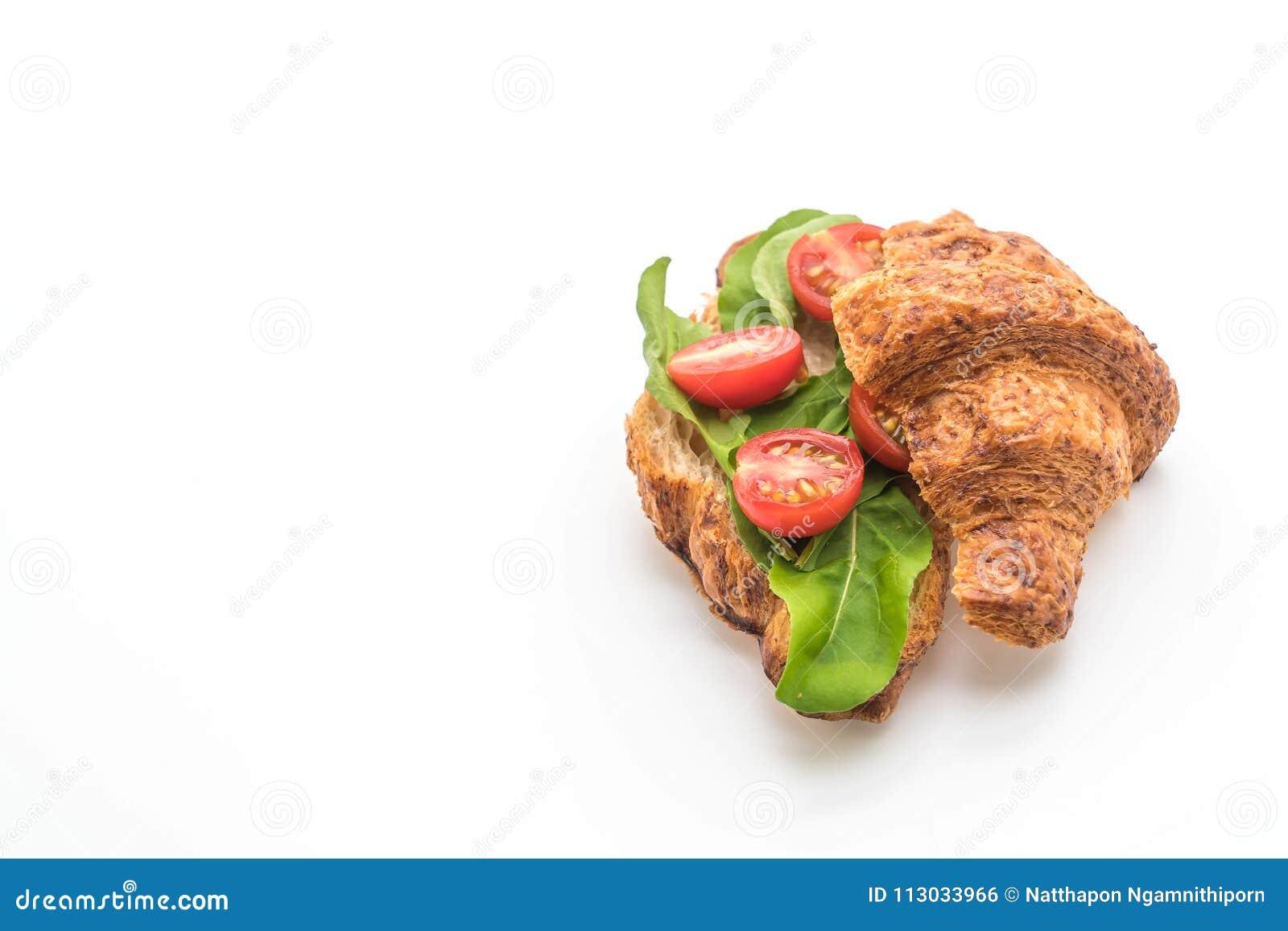 Bocadillo del cruasán de los tomates - sano o estilo de la comida del vegano