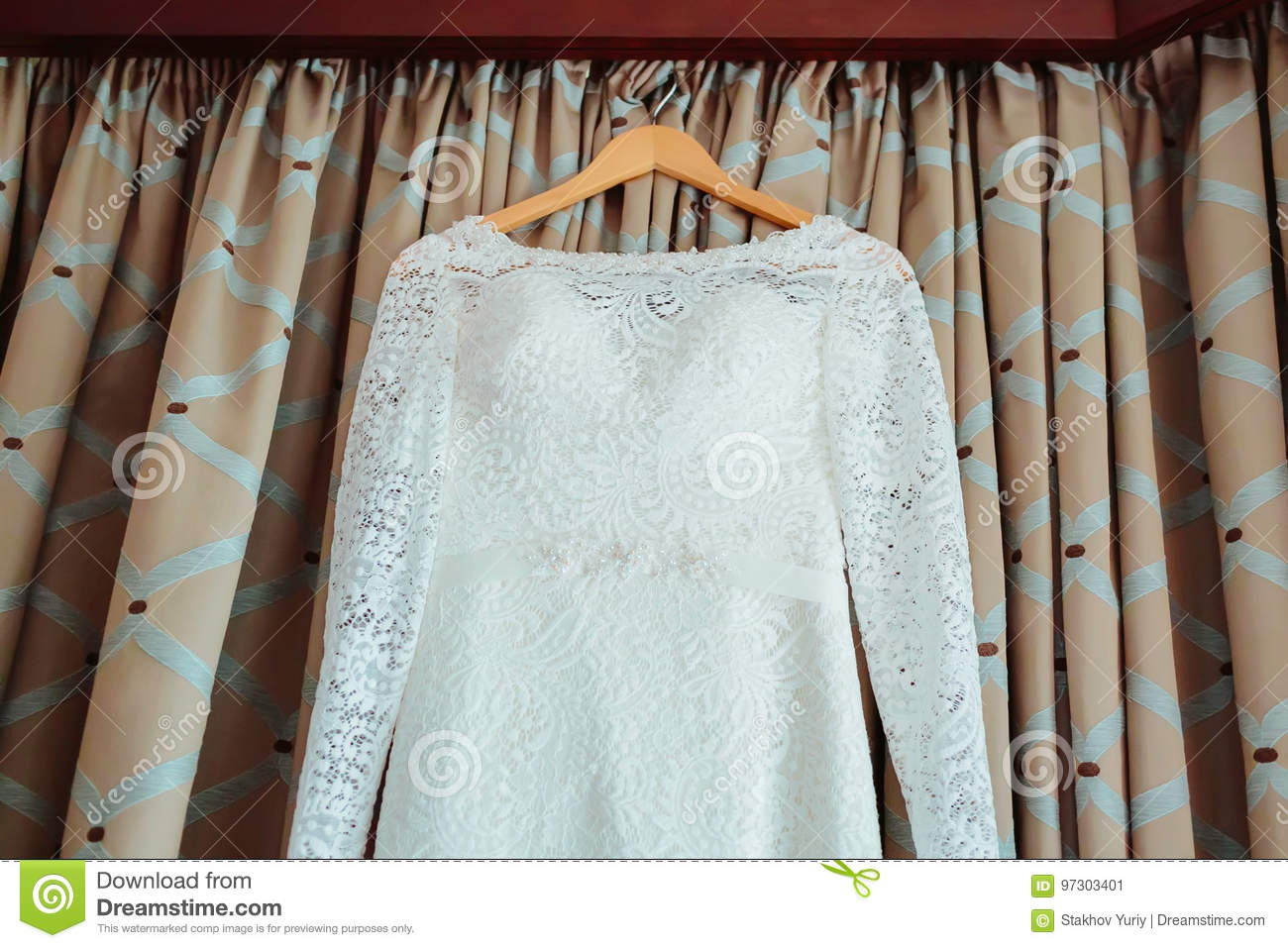 Bodice Of A Wedding Dress Hanging From A Curtain Pole Stock Image ...