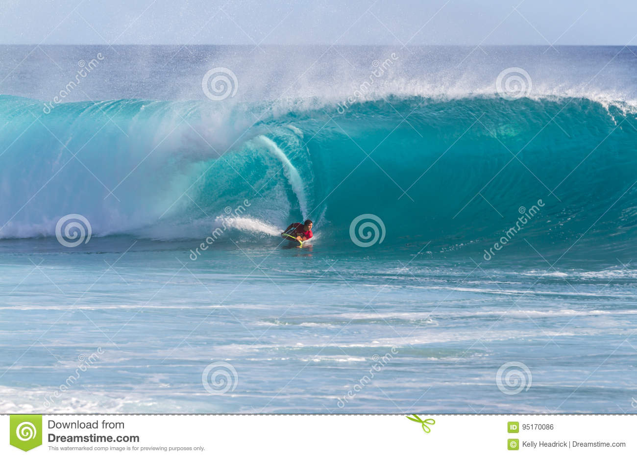 A Body Board Surfer Riding A Wave Editorial Photo - Image of