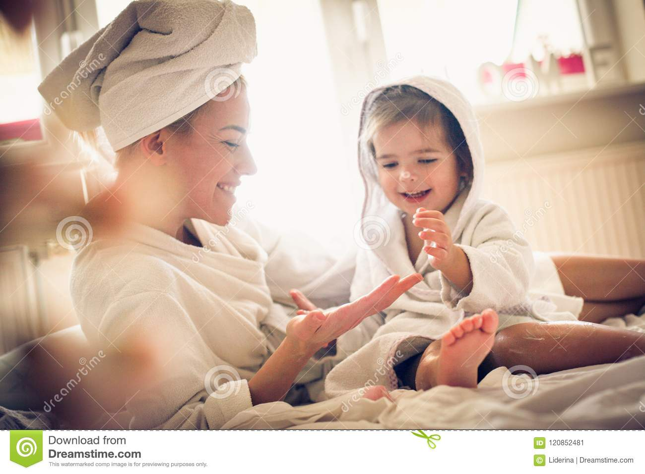 Body care is very important for girls. Mother and daughter.