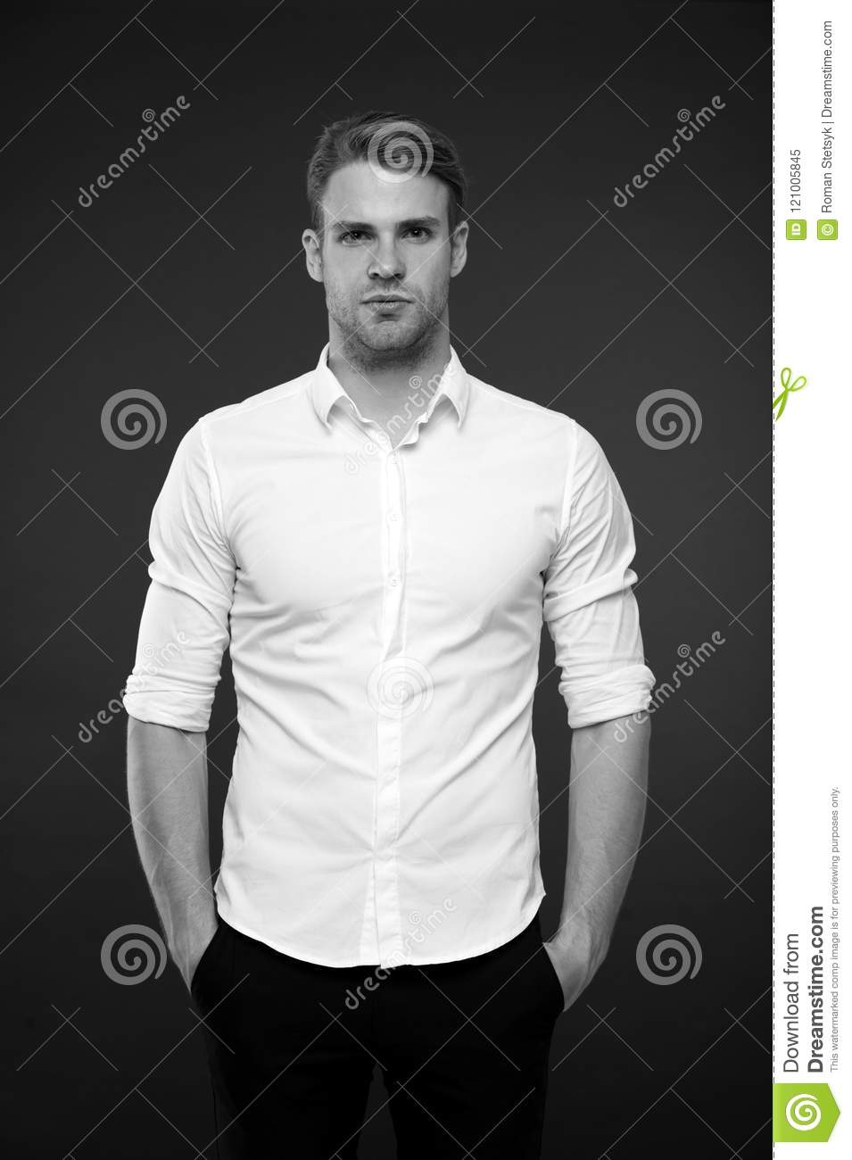 Body language hands in pockets when standing