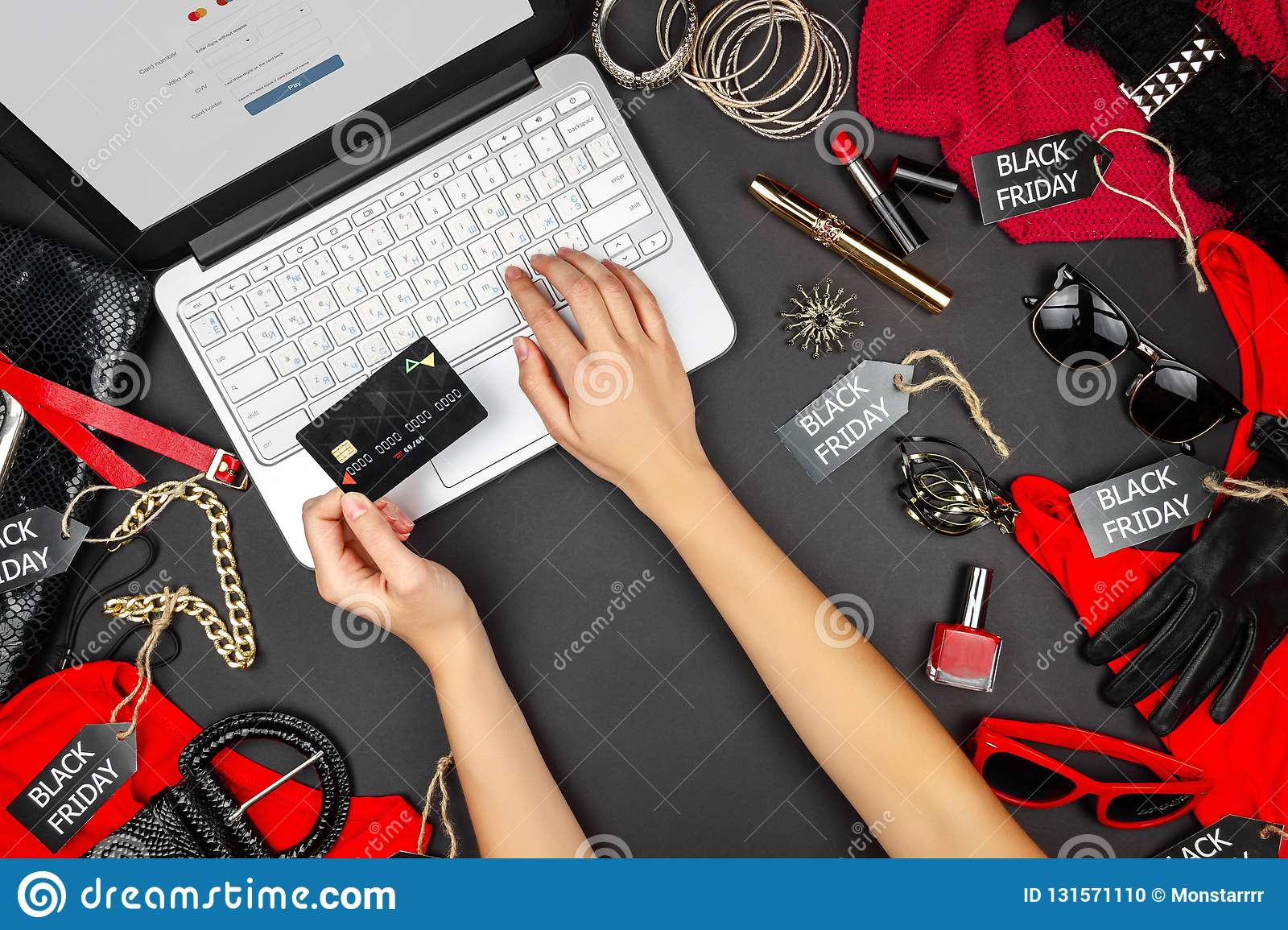 Body part of customer buyers female with debit credit card going to type credit card`s details to buy purchase new fashion goods