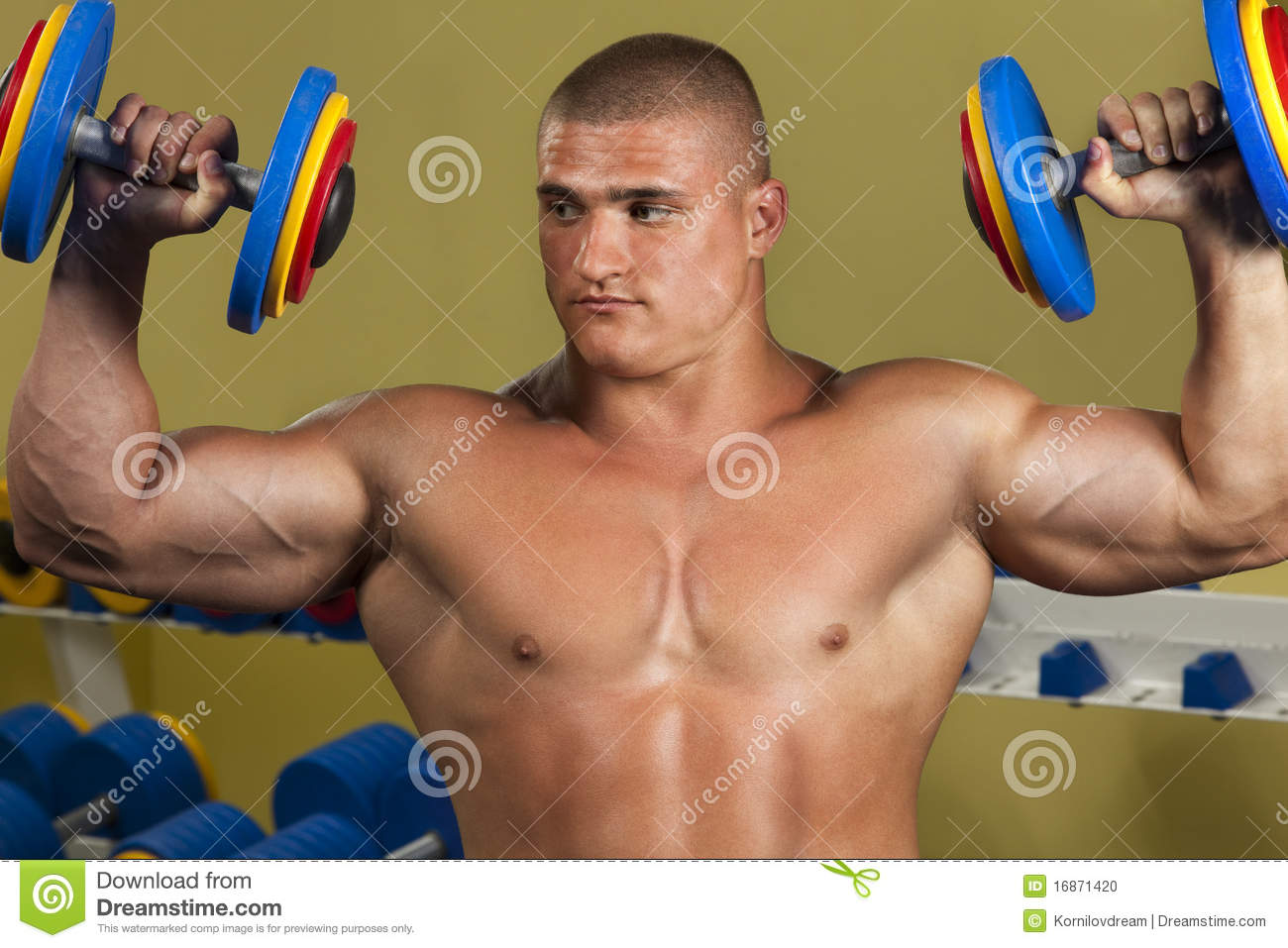 Muscular Man Lifting Weights Stock Photo - Download Image