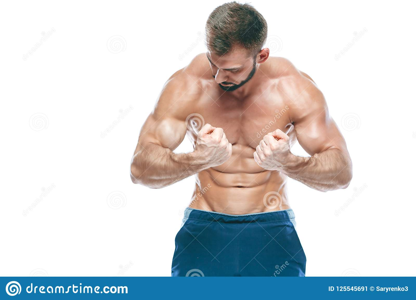 10c4881d712 Beautiful sporty guy male power. Fitness muscled in blue shorts. on  isolated white background. Man with muscular torso. Strong Athletic Man  Fitness Model ...