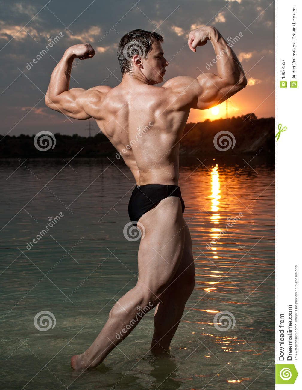Bodybuilder with a sunset