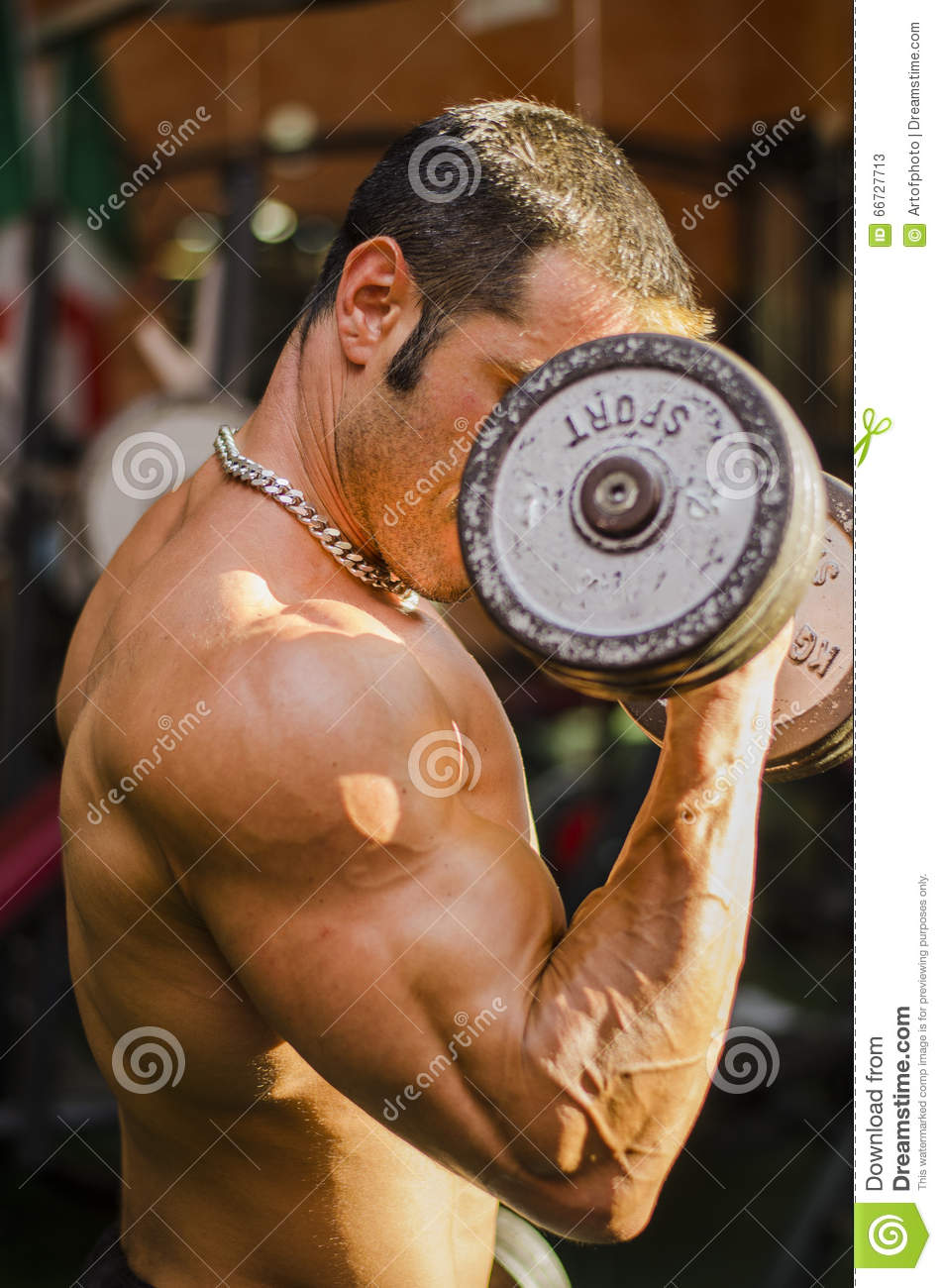Bodybuilder Working Out At Gym Side View Of Muscular Chest Pecs
