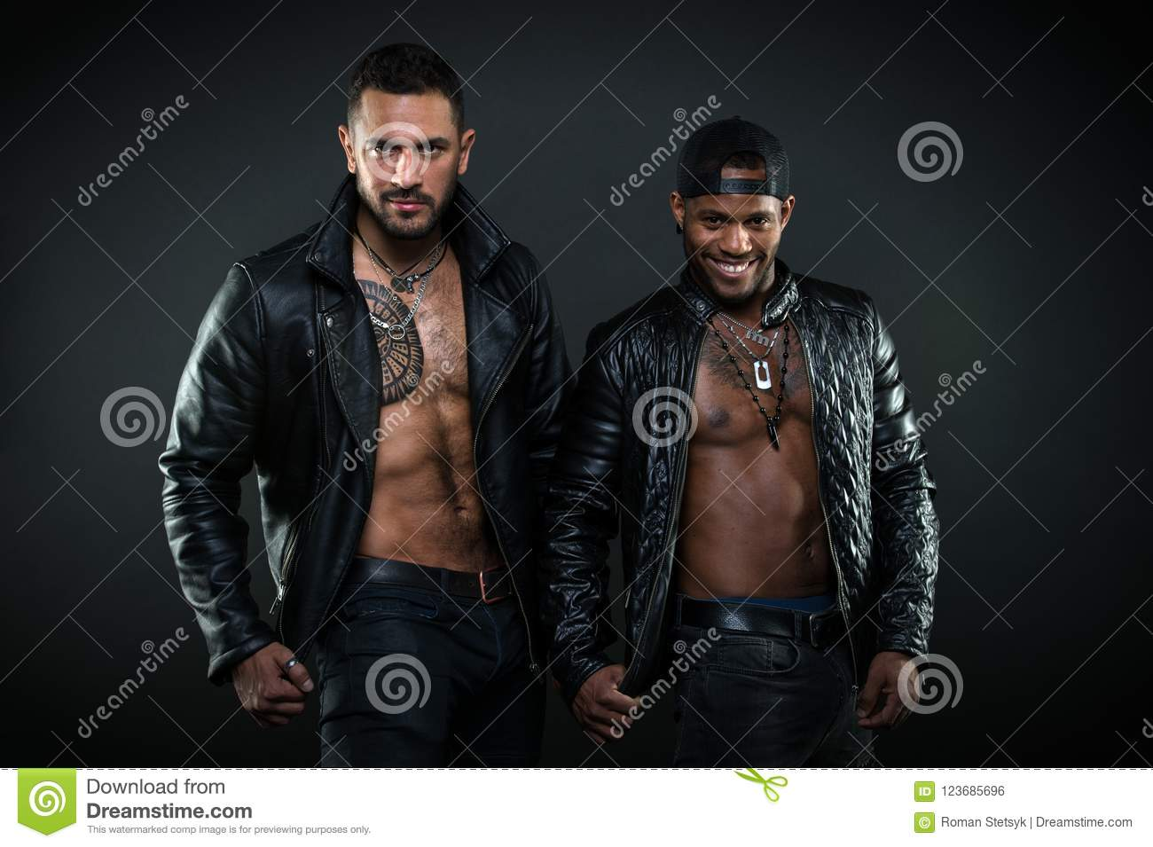 Bodybuilders with bare torsos. Cheerful African men with broad smile  wearing cap. Brutal Caucasian men with tattoo on hairy chest. Bikers in  leather jackets ...