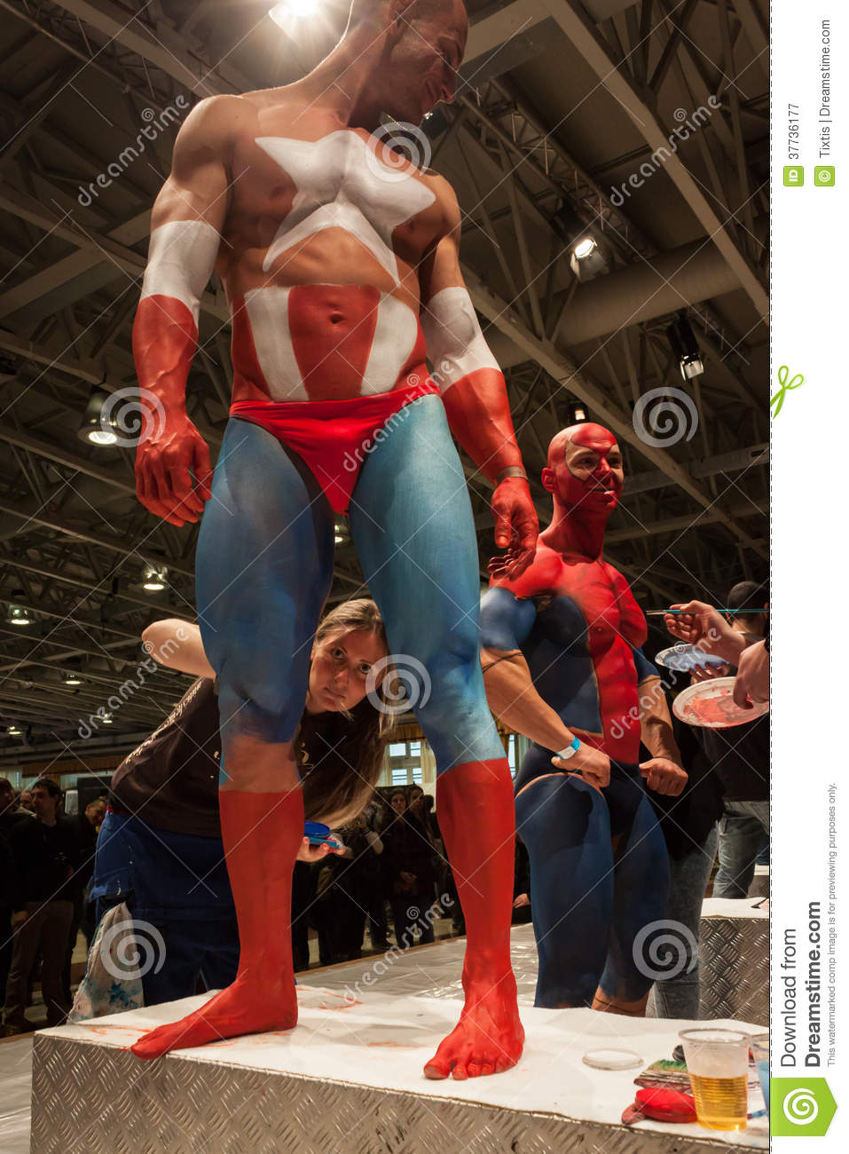 Bodybuilders During A Body Painting Session At Milano