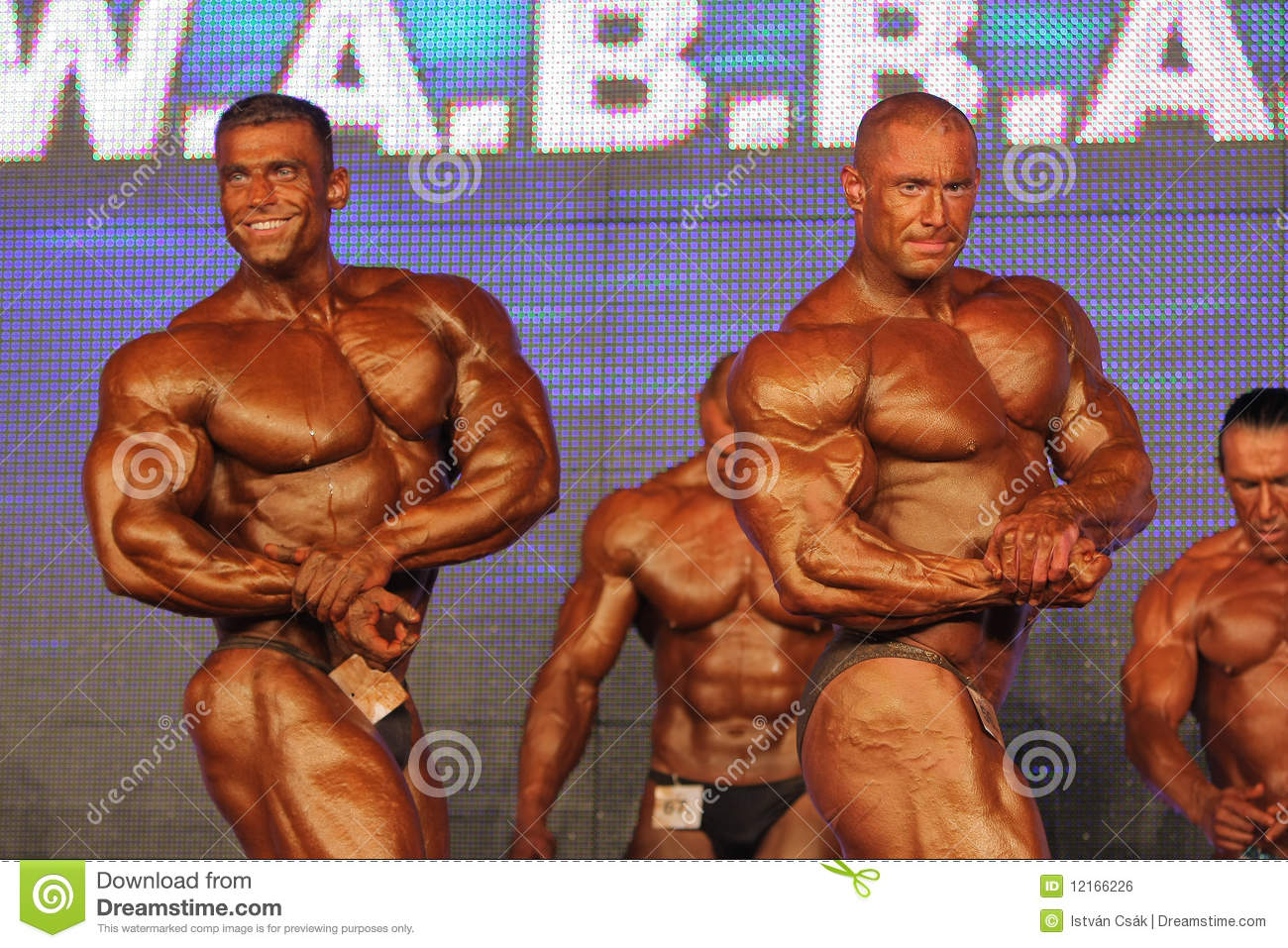 Bodybuilders posing editorial photo. Image of figure
