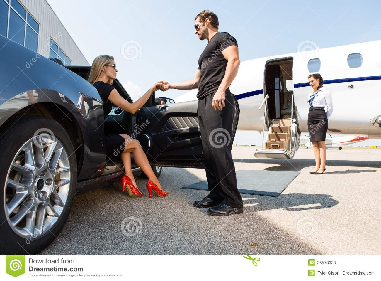 Bodyguard Helping Elegant Woman Stepping Out Of