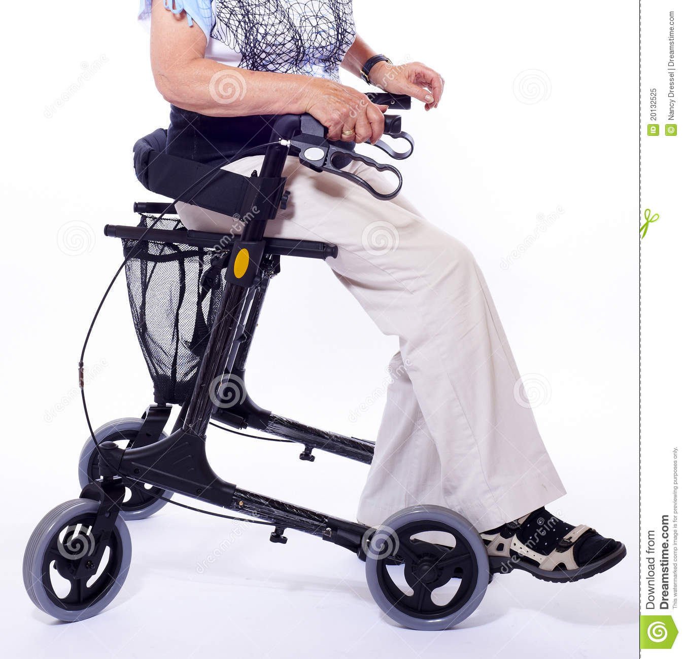 bodypart of elderly woman sitting on walker stock image