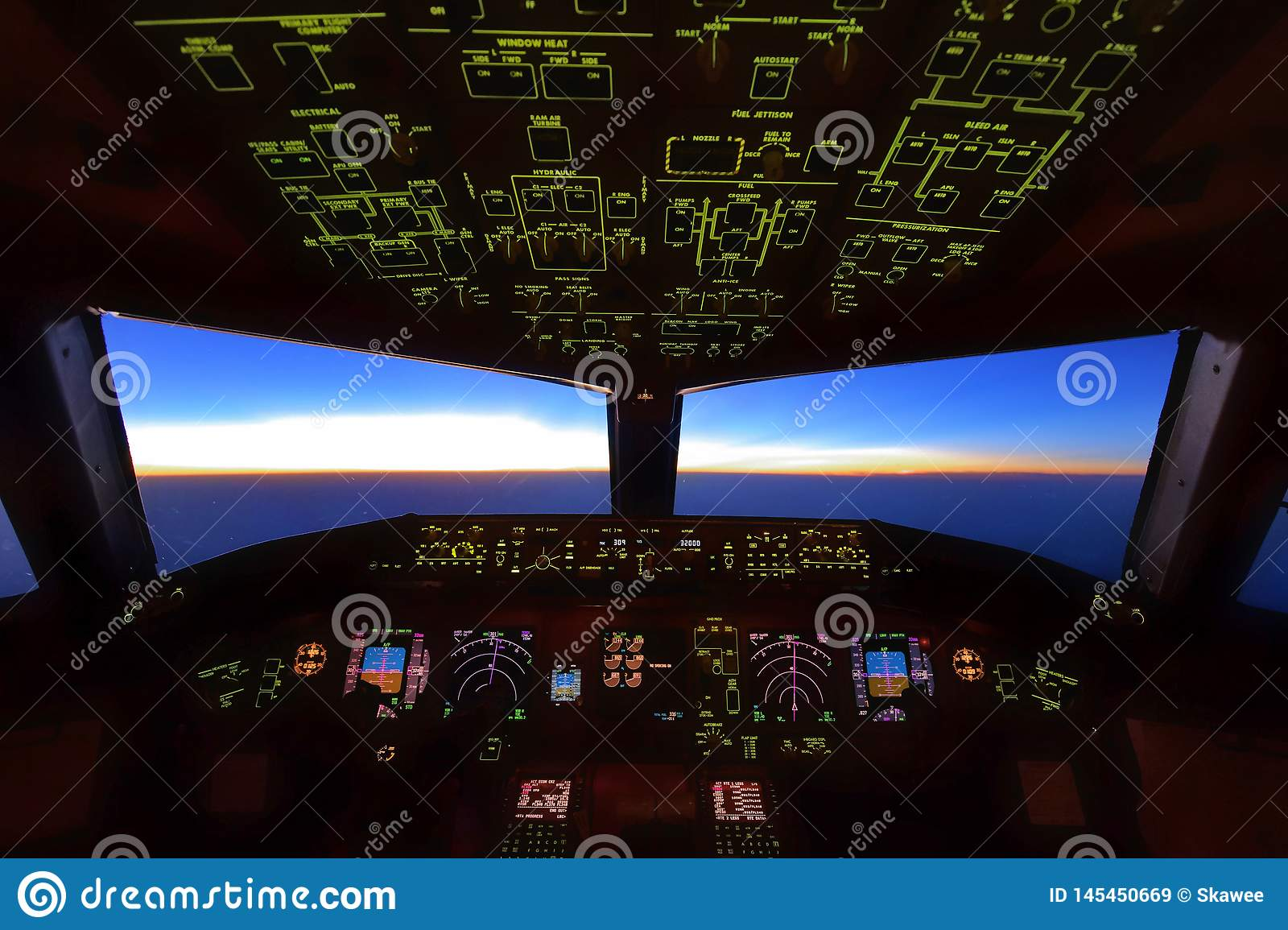 Boeing 777 Cockpit, Flying over over Pacific sea, Pilots were performing their work during sunrise over Japan airspace