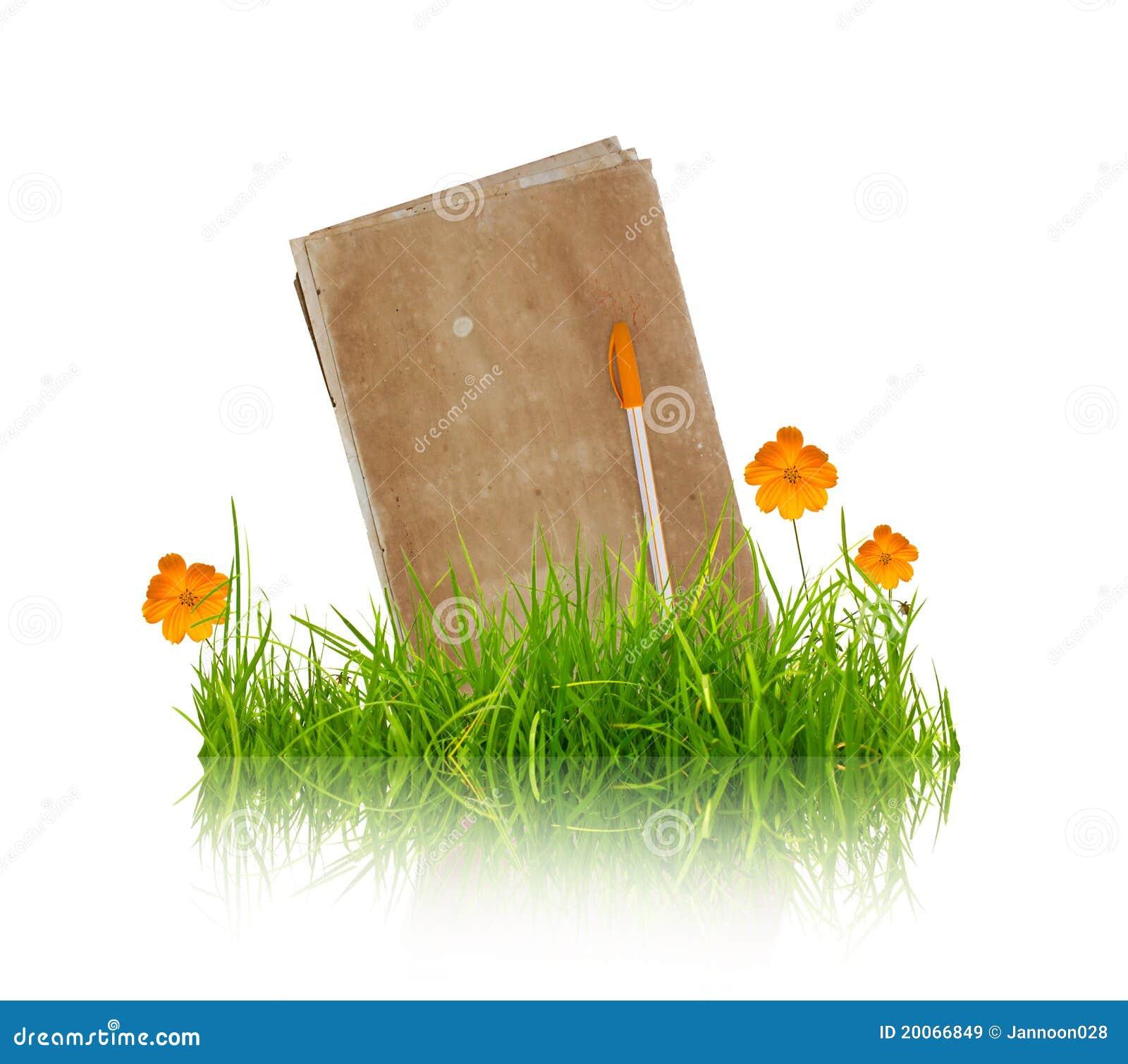 Boek met bloem en gras