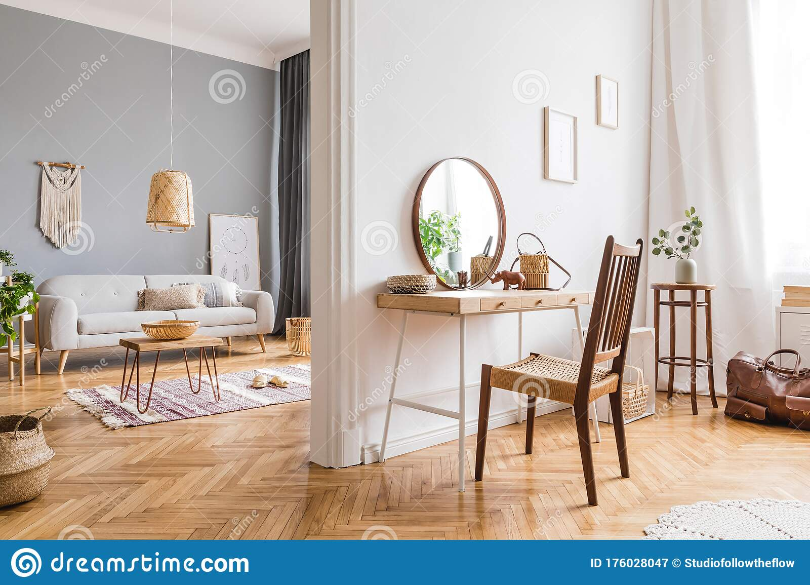 Boho Apartment With Wooden Desk Chair Grey Sofa And Beautiful Accessories Stock Image Image Of Grey Bohemian 176028047