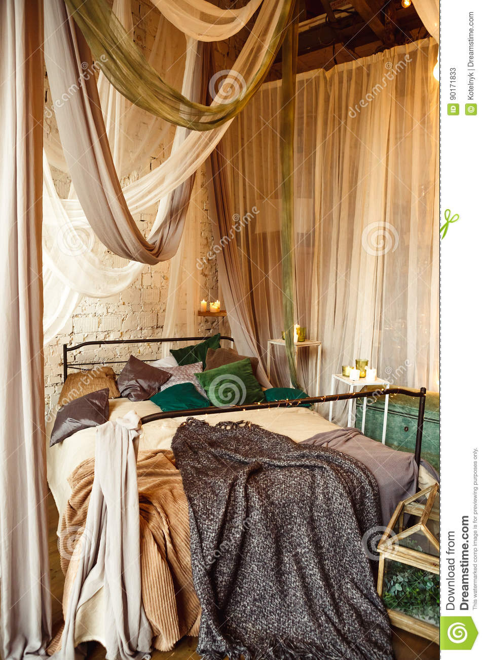 Stylish Bedroom In Boho Style With Grey, White And Green Colors And Many  Candles. Bed With Dark Grey Blanket.