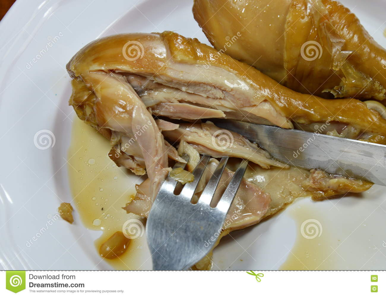Boiled chicken leg in fish sauce slicing by knife stock photo boiled chicken fish knife leg ccuart Image collections