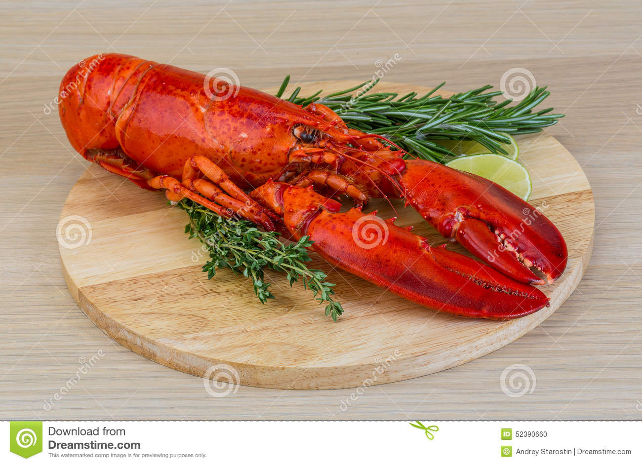 Boiled lobster served with thyme and rosemary.