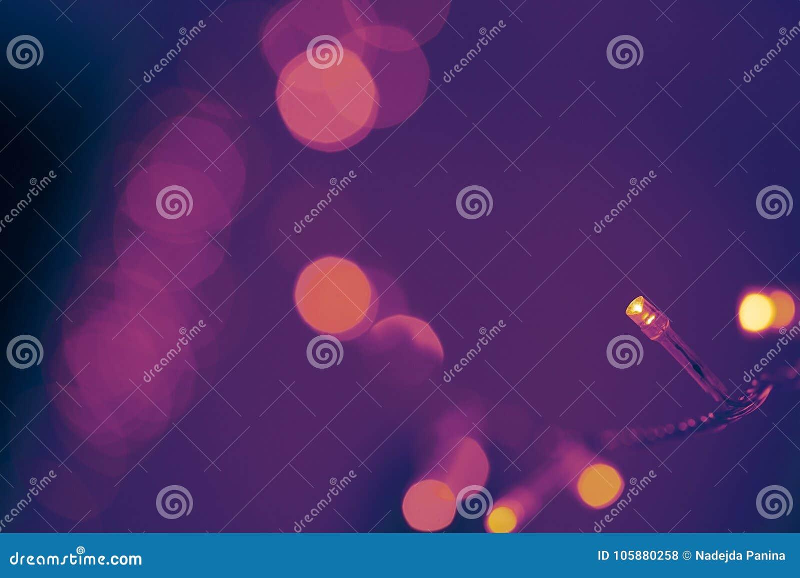 Bokeh светов рождества Ультрафиолетов цвет