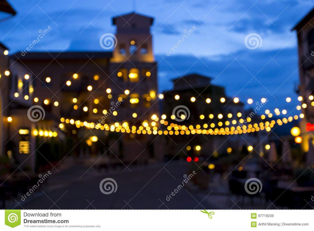 Bokeh background created from picture of decorate light in town square on evening time. Can be use as background for Christmas cel