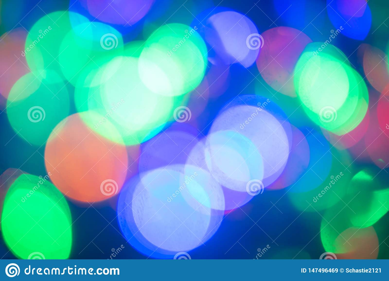 Bokeh. Blurred background. Festive colored lights