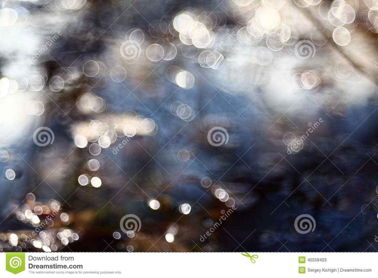 Bokeh blurred blue water reflections