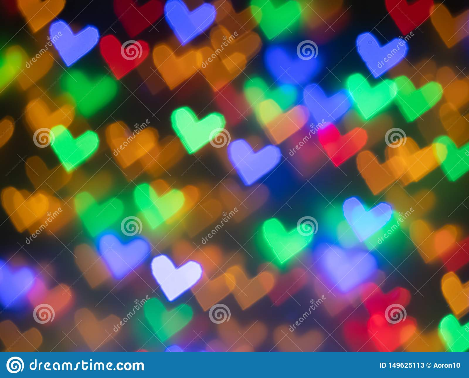 Bokeh colorido de los corazones para el fondo