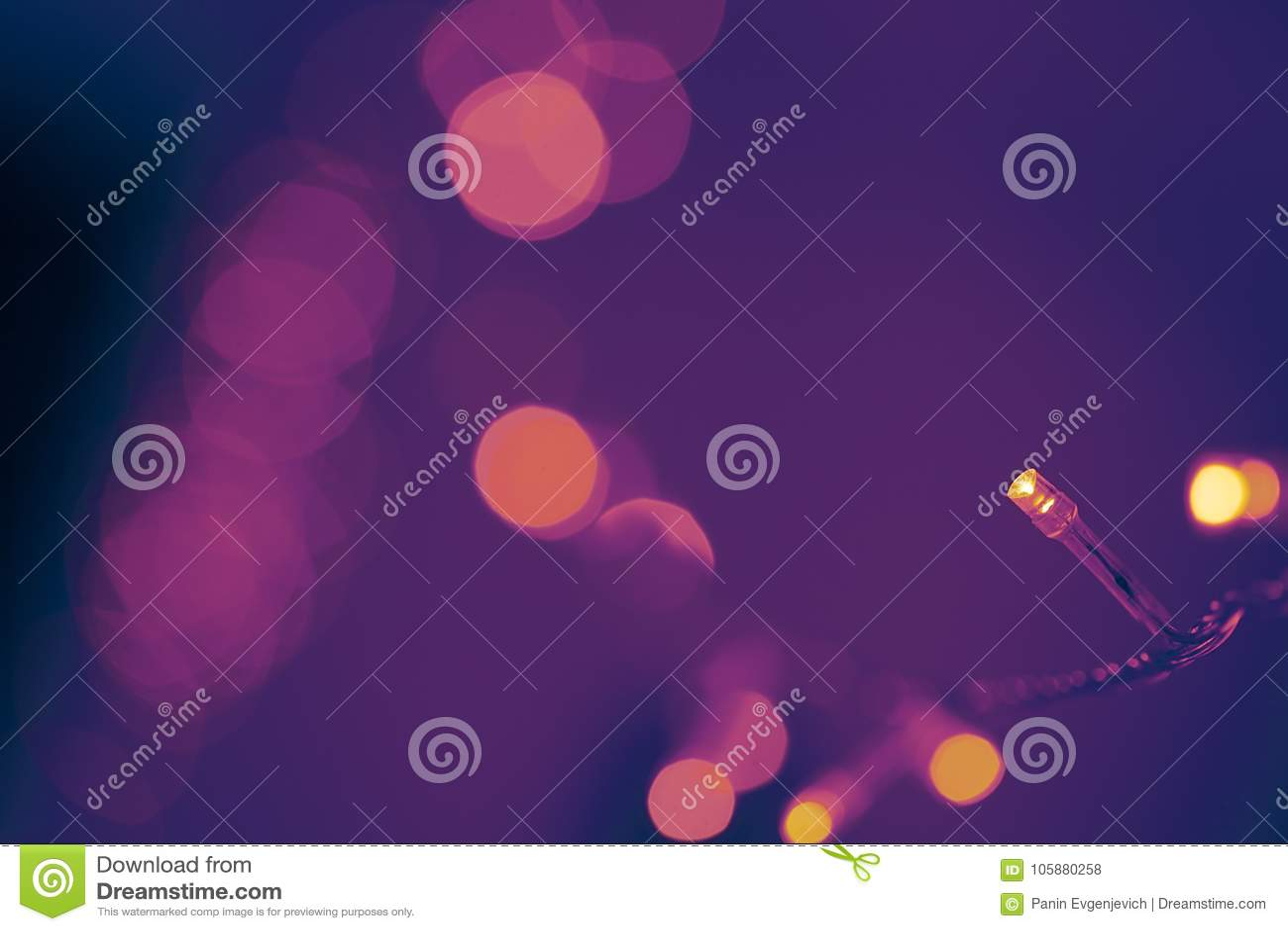 Bokeh de las luces de la Navidad Color ultravioleta