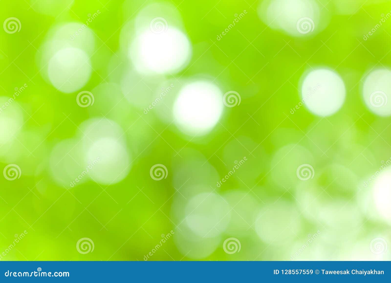 Bokeh do borrão da luz da natureza e sumário verde do fundo