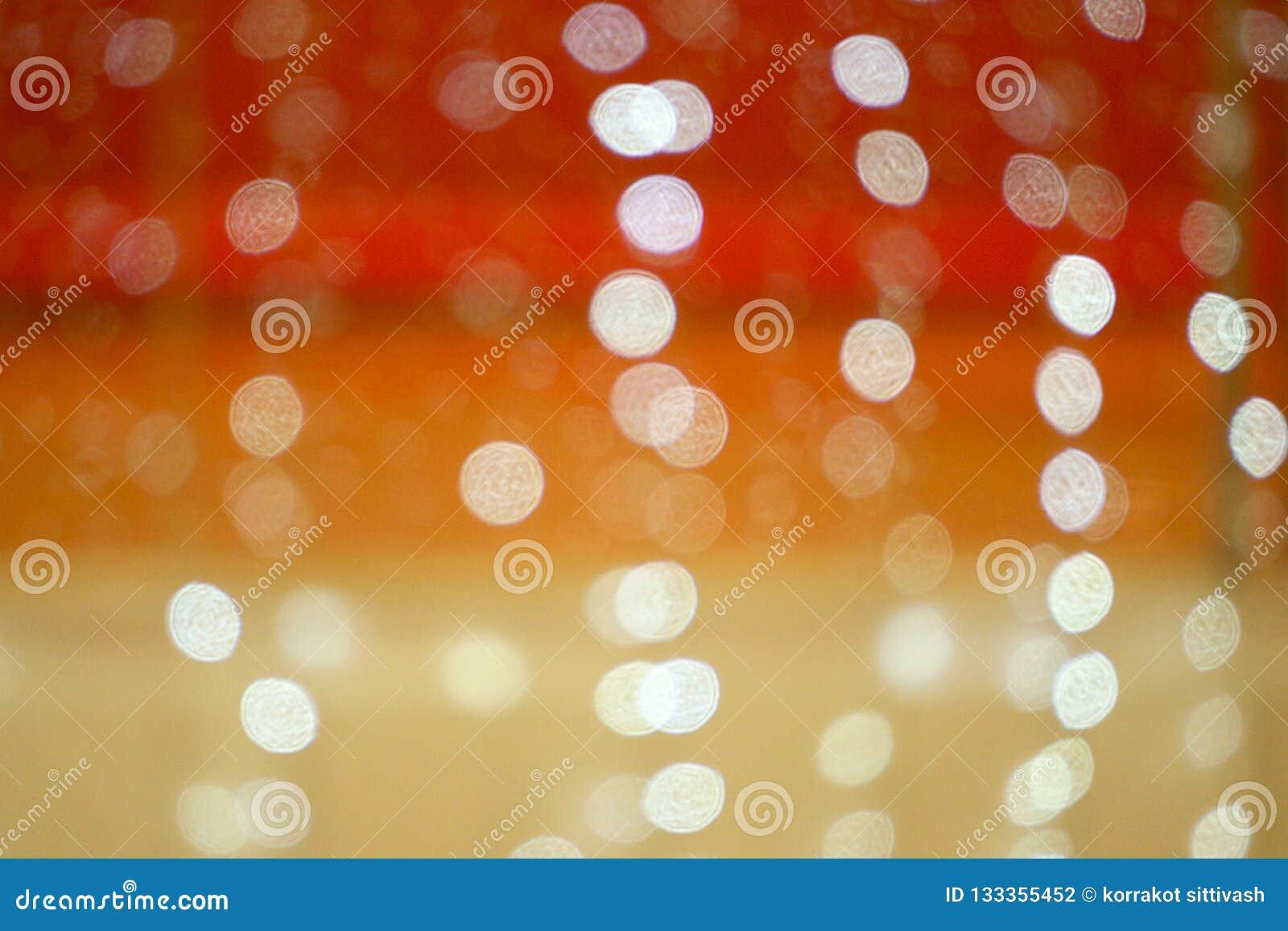 Bokeh JAUNE-ORANGE ROUGE de lumières Fond abstrait brouillé