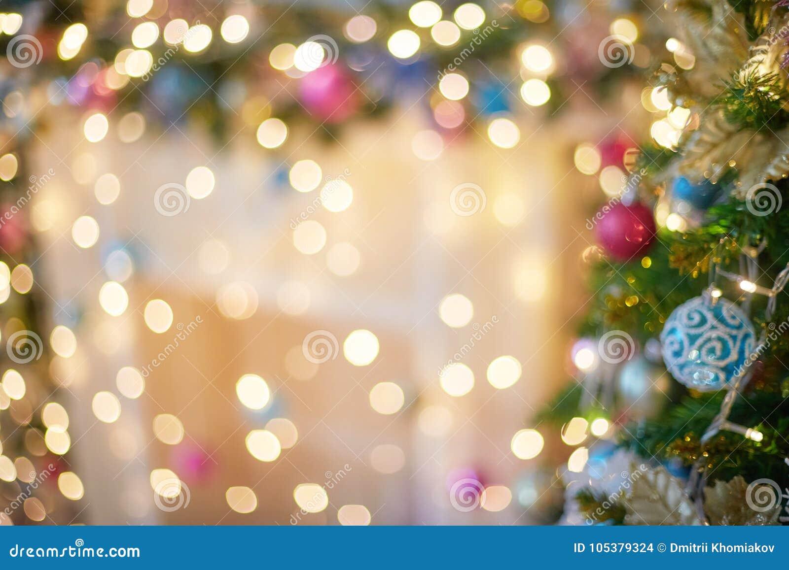 Bokeh vago della luce della ghirlanda Modello della sfuocatura di Natale, fondo defocused
