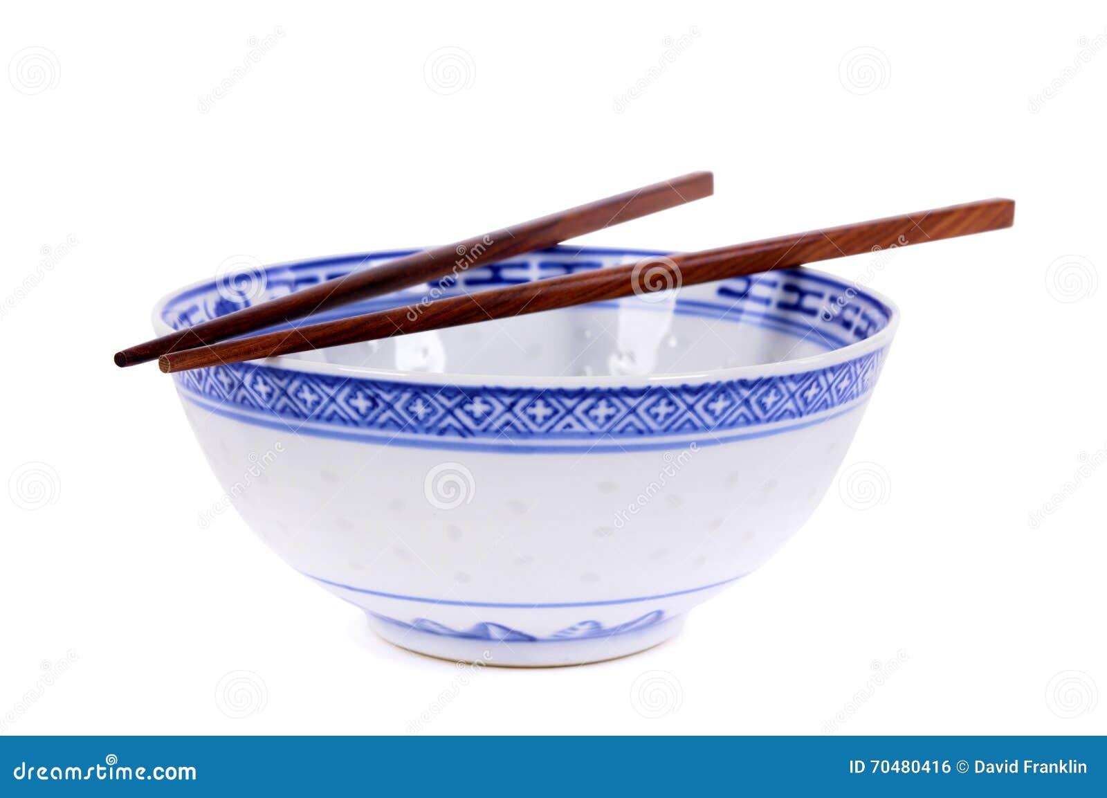 Bol de riz chinois vide de modèle bleu classique avec le chopsti en bois