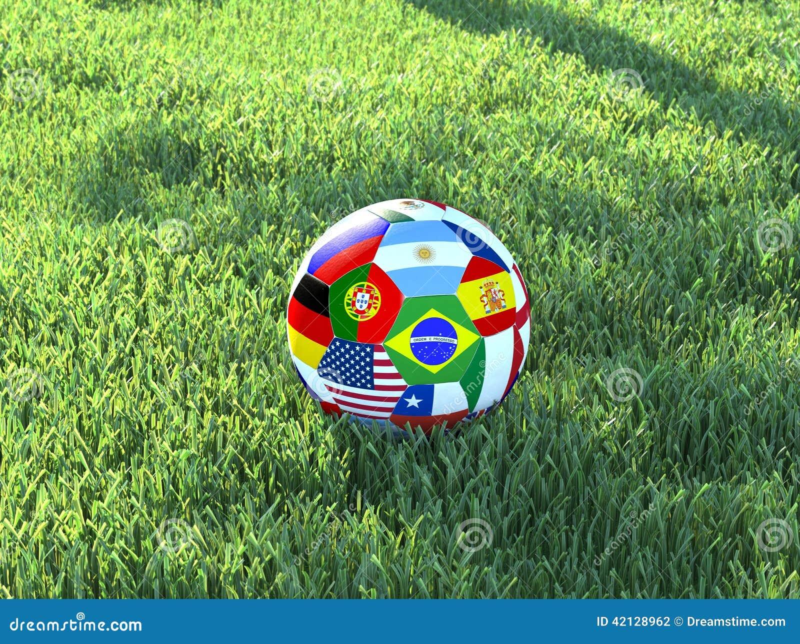 A bola de futebol embandeira a grama