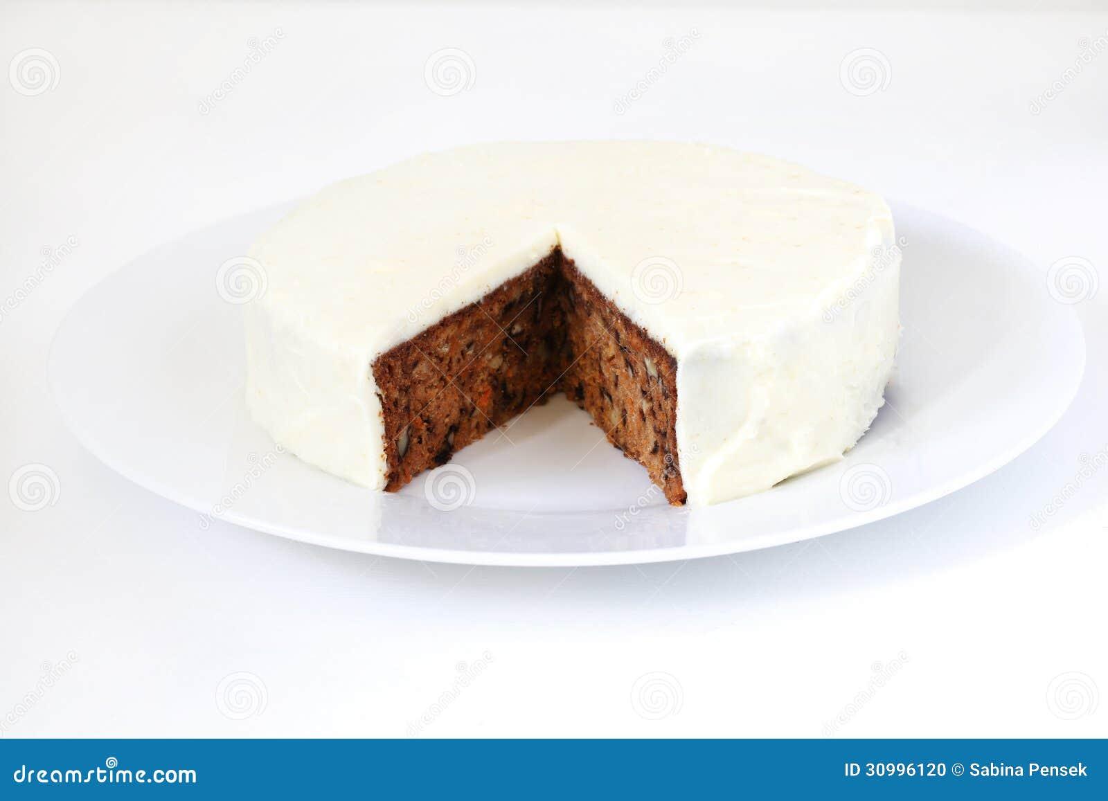 Bolo de cenoura com crosta de gelo das nozes, do queijo creme e do açúcar